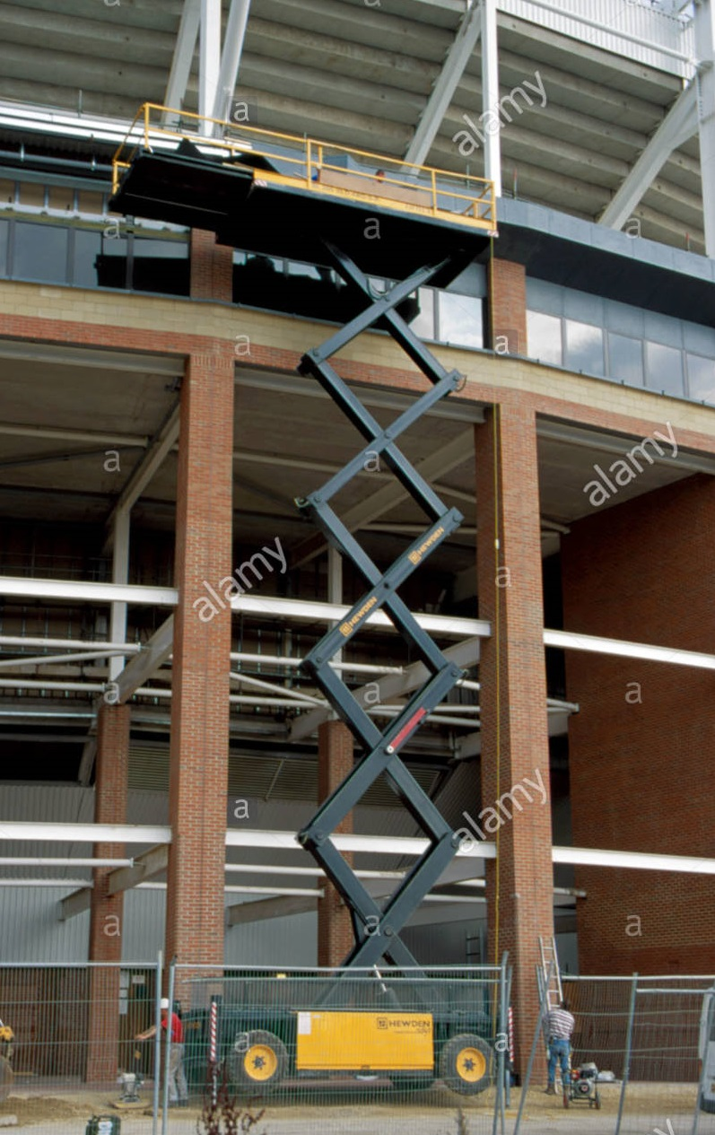 scissor lift being used to permit the inspection of stadium of light A4EECC